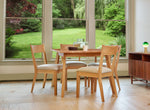 Modern dining room with square Lagom table and four Fika Chairs in white oak with view of yard through large windows