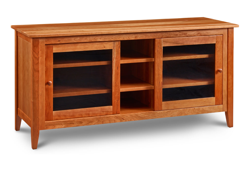 Medium Pine Point Media Console in solid cherry with centered open shelves and shelves with sliding glass doors on either side