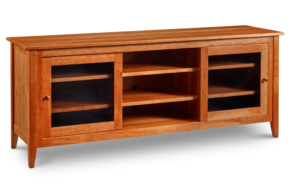 Large Pine Point Media Console in solid cherry with centered open shelves and shelves with sliding glass doors on either side