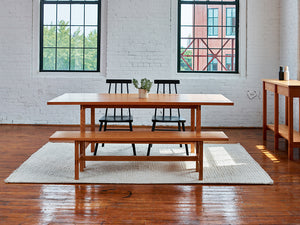 Warehouse loft dining room furnished with modern Union Sideboard, Table and Bench from Maine's Chilton Furniture Co.
