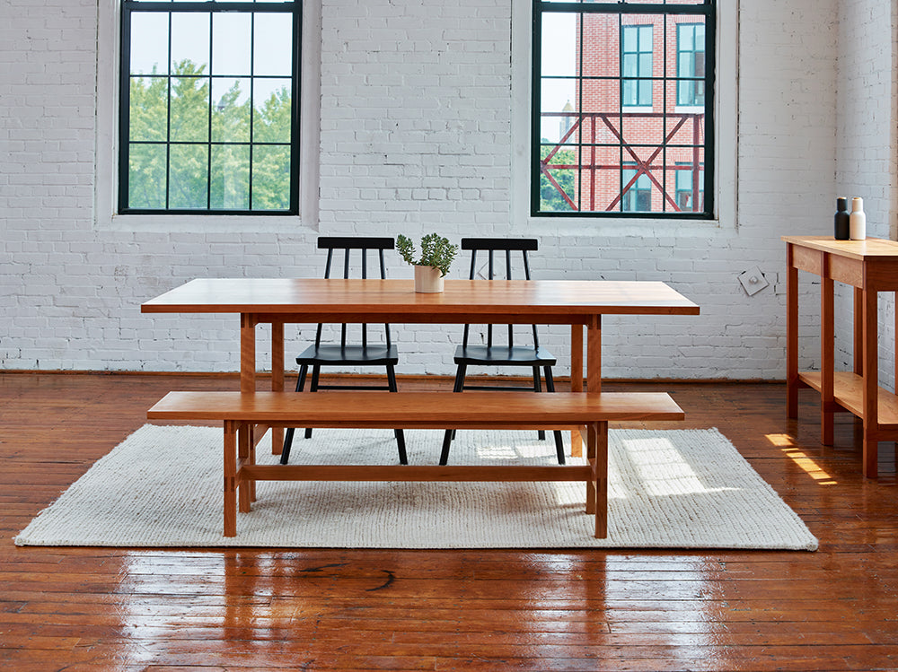 Warehouse loft dining room furnished with modern Union Table and Bench from Maine's Chilton Furniture Co.