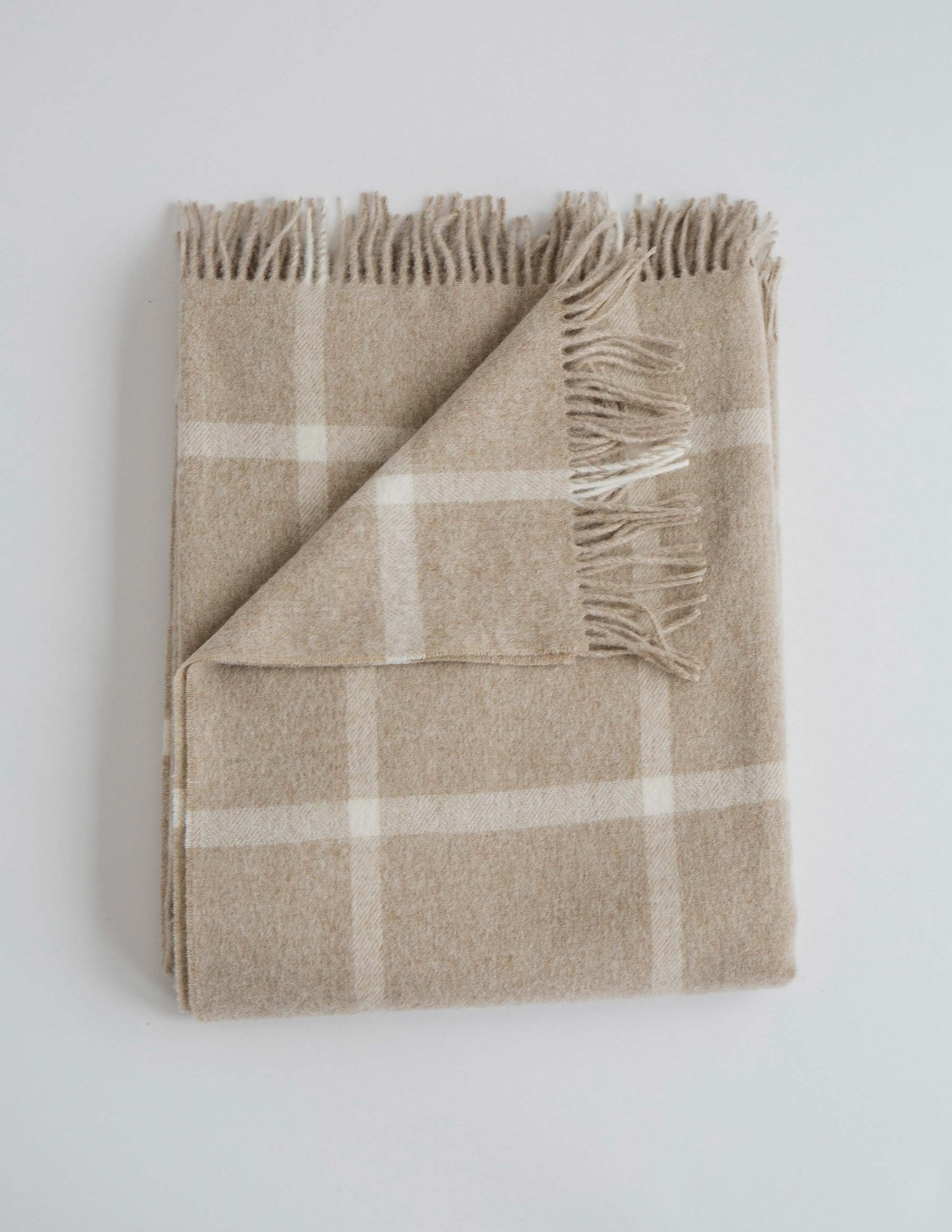 Soft cream checker patterned merino throw blanket