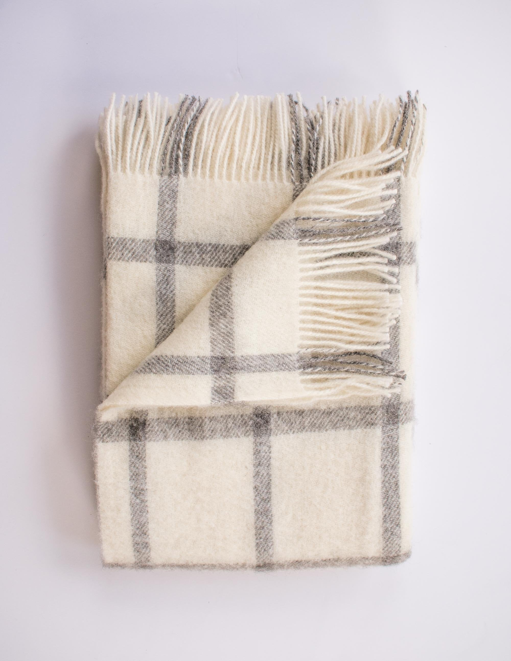 Soft white and grey checker patterned merino throw blanket