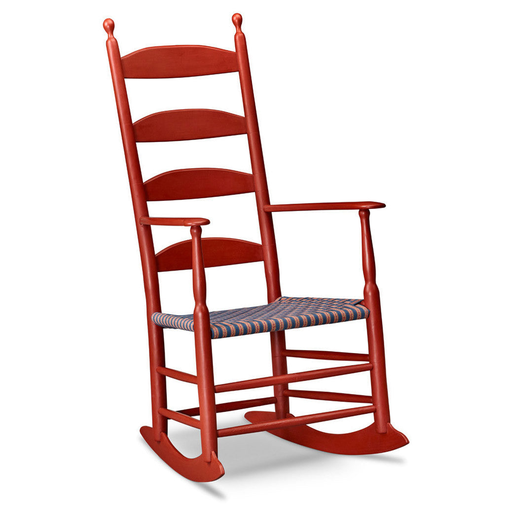 Traditional Shaker rocking chair in red paint with tall four slat ladder back and taped seat