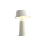 Small white cordless lamp with cylindrical base and tilted shade