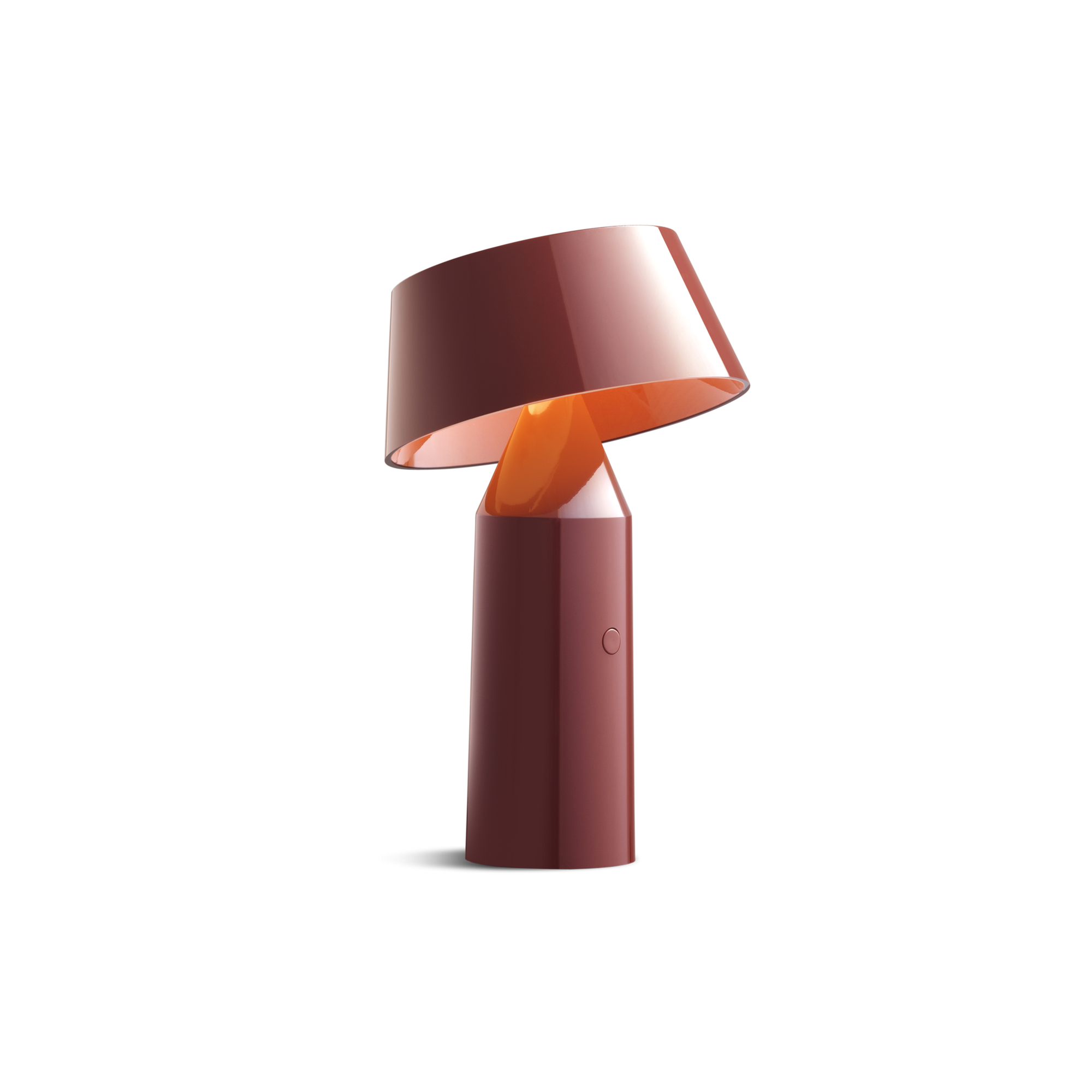 Small red cordless lamp with cylindrical base and tilted shade