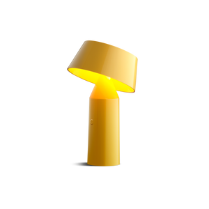 Small yellow cordless lamp with cylindrical base and tilted shade