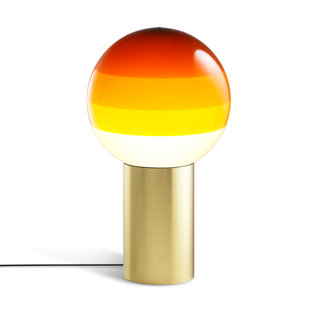 Large lamp with gold base and amber glass sphere with layered shades from white to brown