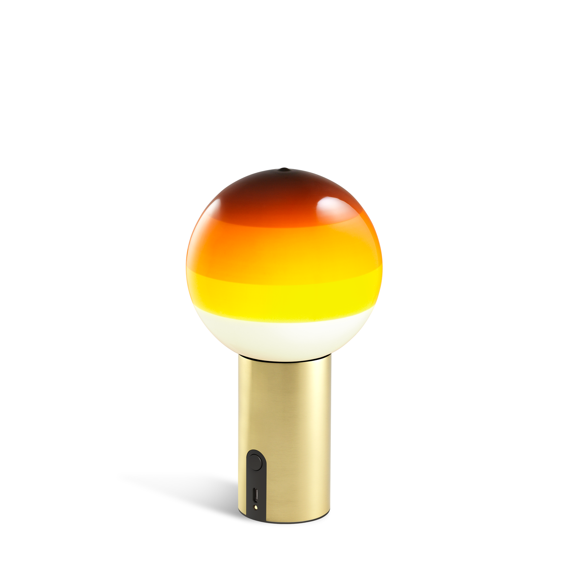 Small portable lamp with brass base and amber glass sphere with layered shades from white to yellow to dark amber