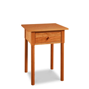 Modern interpretation of a classic Shaker style nightstand with one drawer and rounded legs, in solid cherry wood