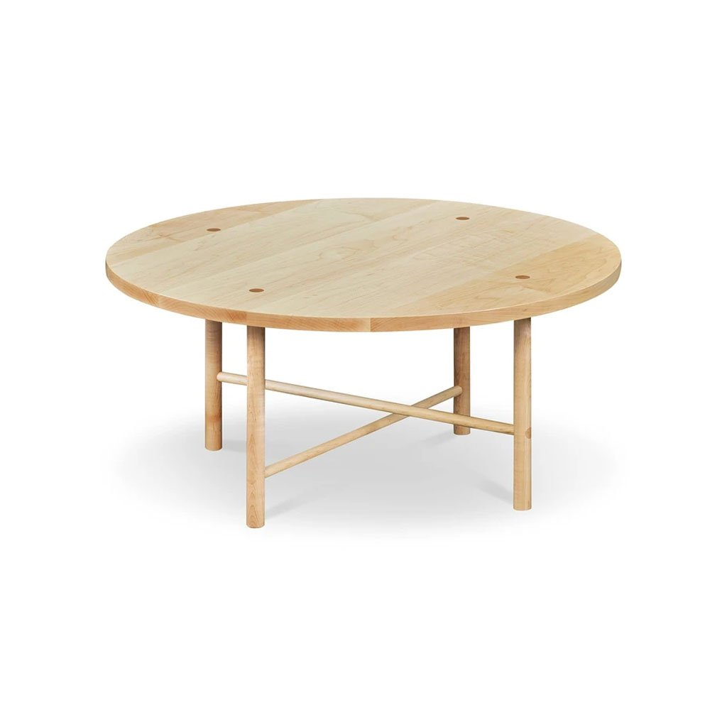 Round Scandinavian style coffee table with round legs in clear maple