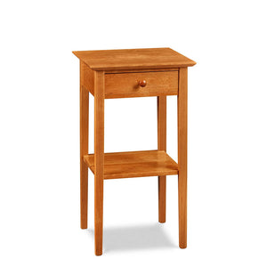 Simple Shaker nightstand with one drawer, shelf, and tapered legs, in cherry wood, from Maine's Chilton Furniture Co.