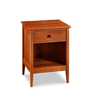 Simple Shaker nightstand with one drawer and tapered legs, in cherry wood, from Maine's Chilton Furniture Co.