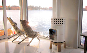 Modern Scandinavian Style wood-burning stove, in white with oak wood base