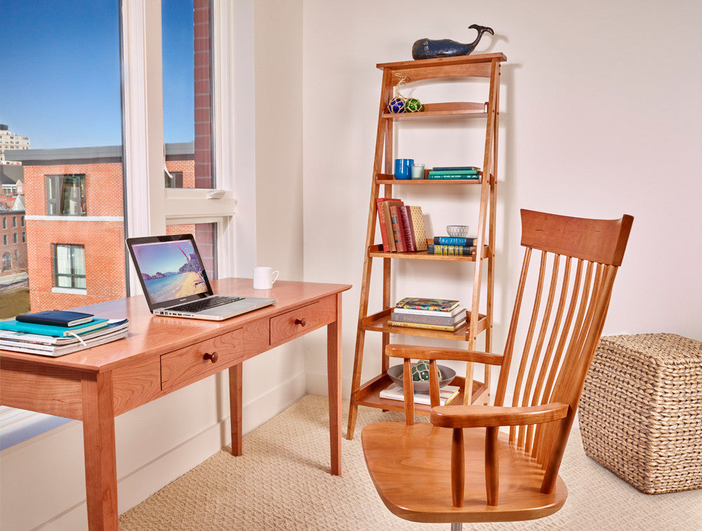 Office space with great view, furnished with Oxford rolling desk chair, Shaker writing desk, and ladder shelf, all built in cherry