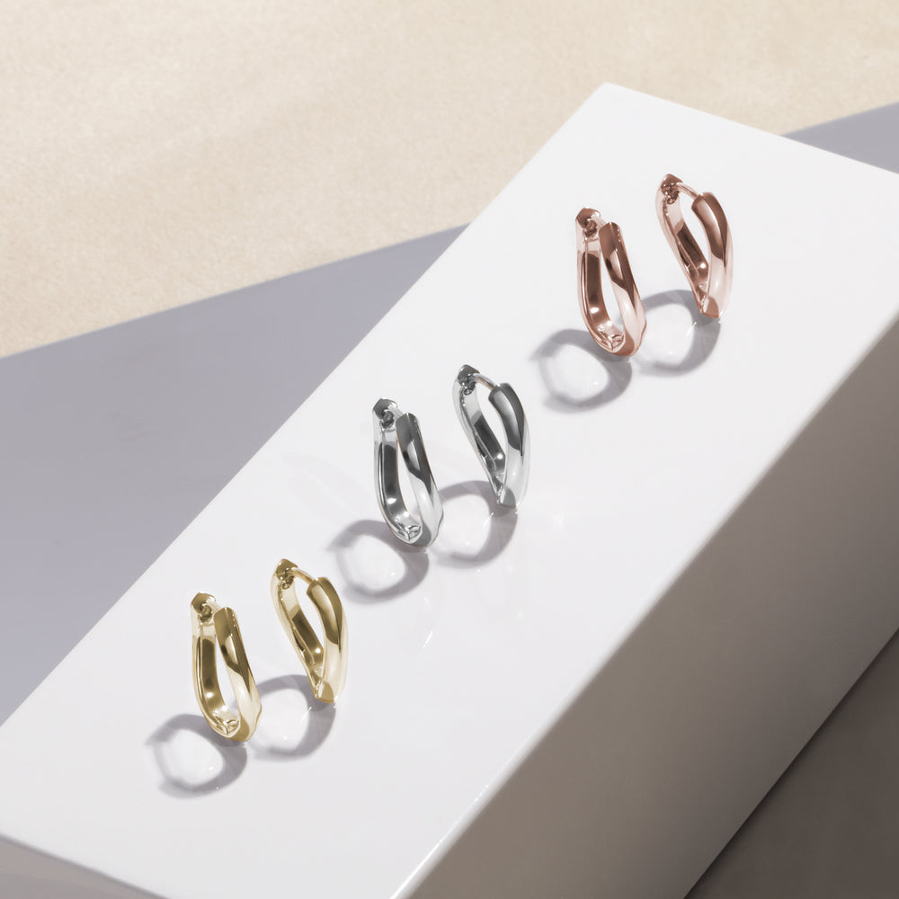 minimal twist rose gold stainless steel huggie earrings