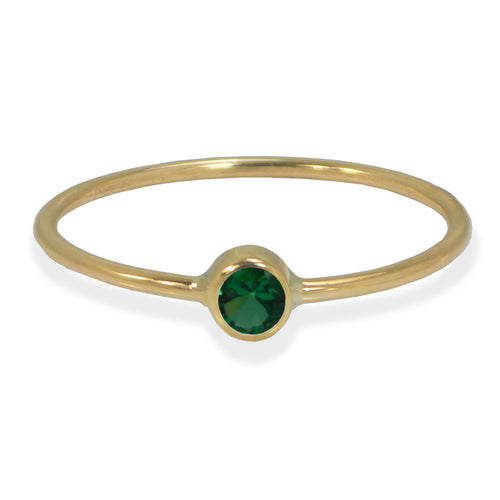Emerald bezel ring in yellow gold