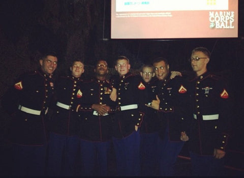 Attendees posing for a photo at the Marine Corps Ball.
