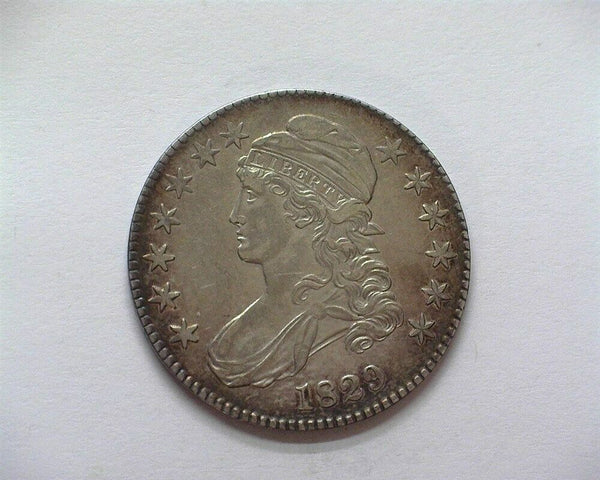 1829 Capped Bust Half Dollar AU-50 - Of Coins & Crystals