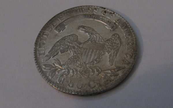 1832 Capped Bust Half Dollar.  AU-50 | Of Coins & Crystals