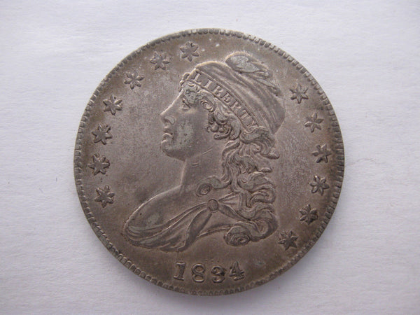 1834 Capped Bust Half Dollar. AU-50 - Of Coins & Crystals