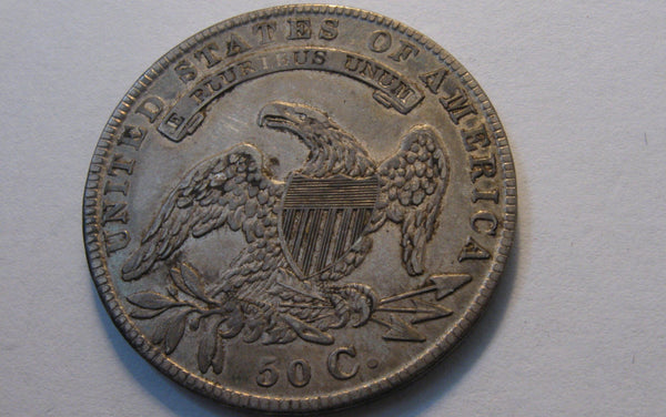 1834 Capped Bust Half Dollar. AU-50 | Of Coins & Crystals