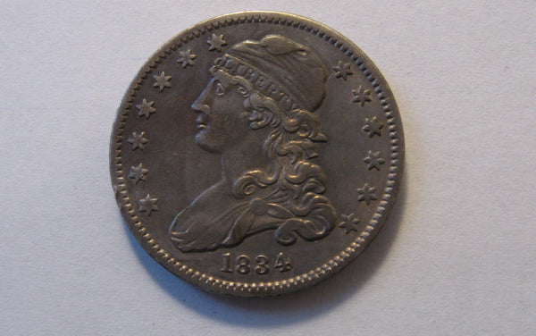 1834 Capped Bust Quarter.  AU-50 - Of Coins & Crystals