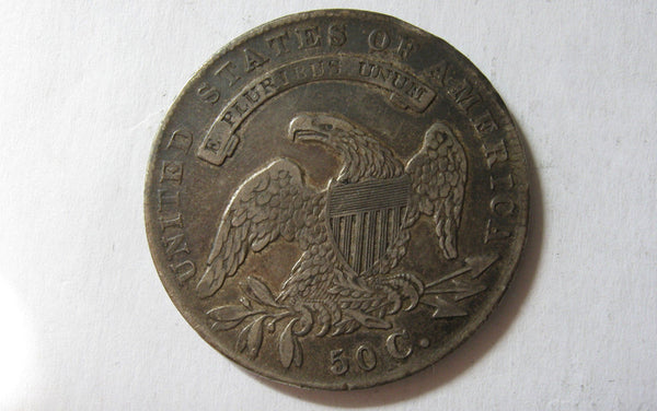 1835 Capped Bust Half Dollar.  XF-40 - Of Coins & Crystals