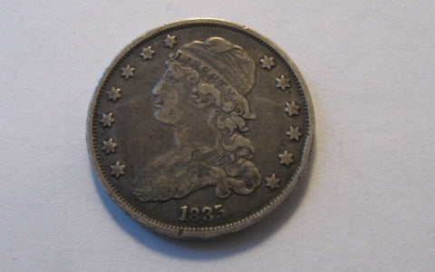1835 Capped Bust Quarter. VF-30 - Of Coins & Crystals