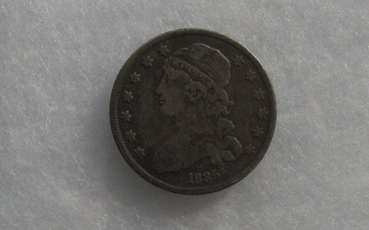 1835 Capped Bust Quarter VF-20 - Of Coins & Crystals