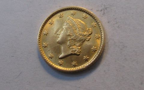 1854 Liberty Head Gold Dollar.  MS-62 - Of Coins & Crystals