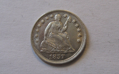 1857 Seated Liberty Half Dime.  AU-50 - Of Coins & Crystals