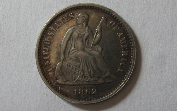 1862 Seated Liberty Half Dime.  MS-62 - Of Coins & Crystals