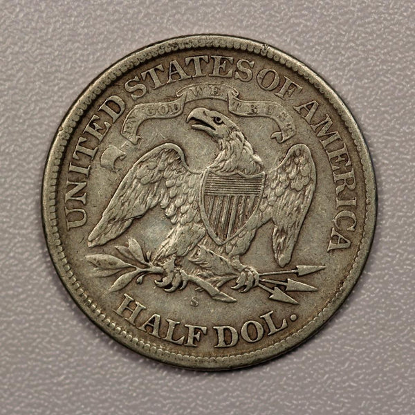 1870S Seated Liberty Half Dollar VF-30 - Of Coins & Crystals