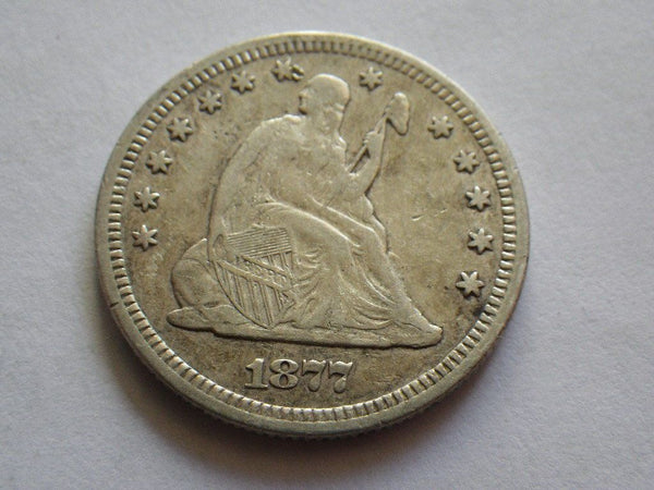 1877 Seated Liberty Quarter VF-30 - Of Coins & Crystals