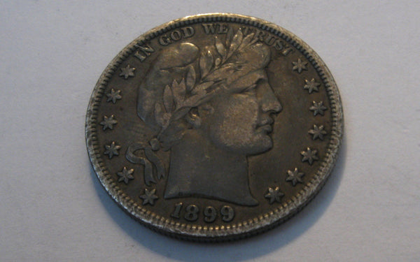 1899 Barber Half Dollar.  VF-20 - Of Coins & Crystals