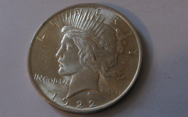 1922 Peace Dollar.  MS-64 - Of Coins & Crystals