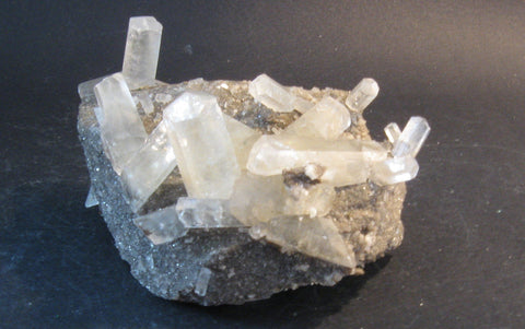 Calcite Points on Matrix - Of Coins & Crystals