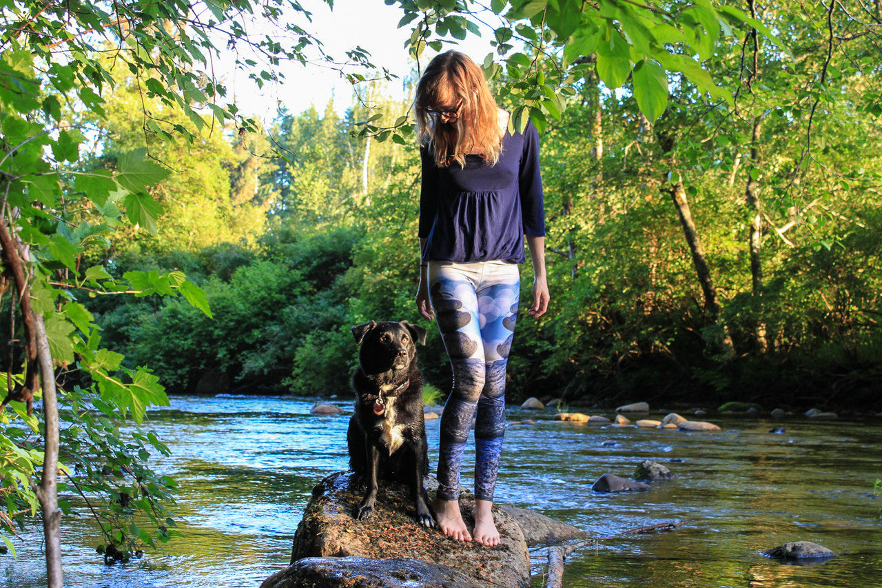 zen leggings by wildandroaming - woman with dog by the river at sunset wearing leggings