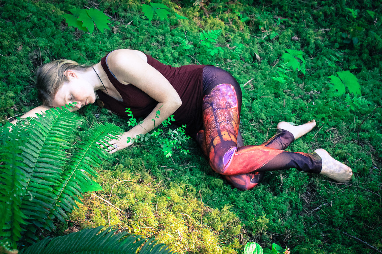 fleur fatale leggings by wildandroaming - woman lying in the forest on a bed of moss