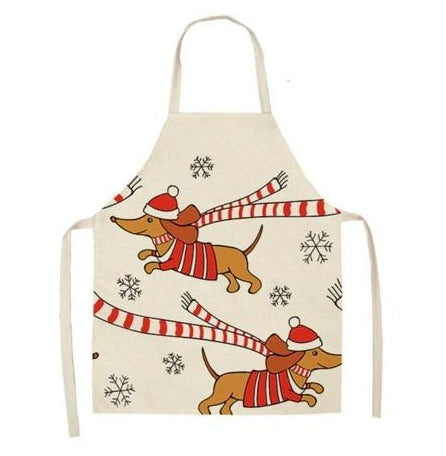 dachshunds in winter gear on apron