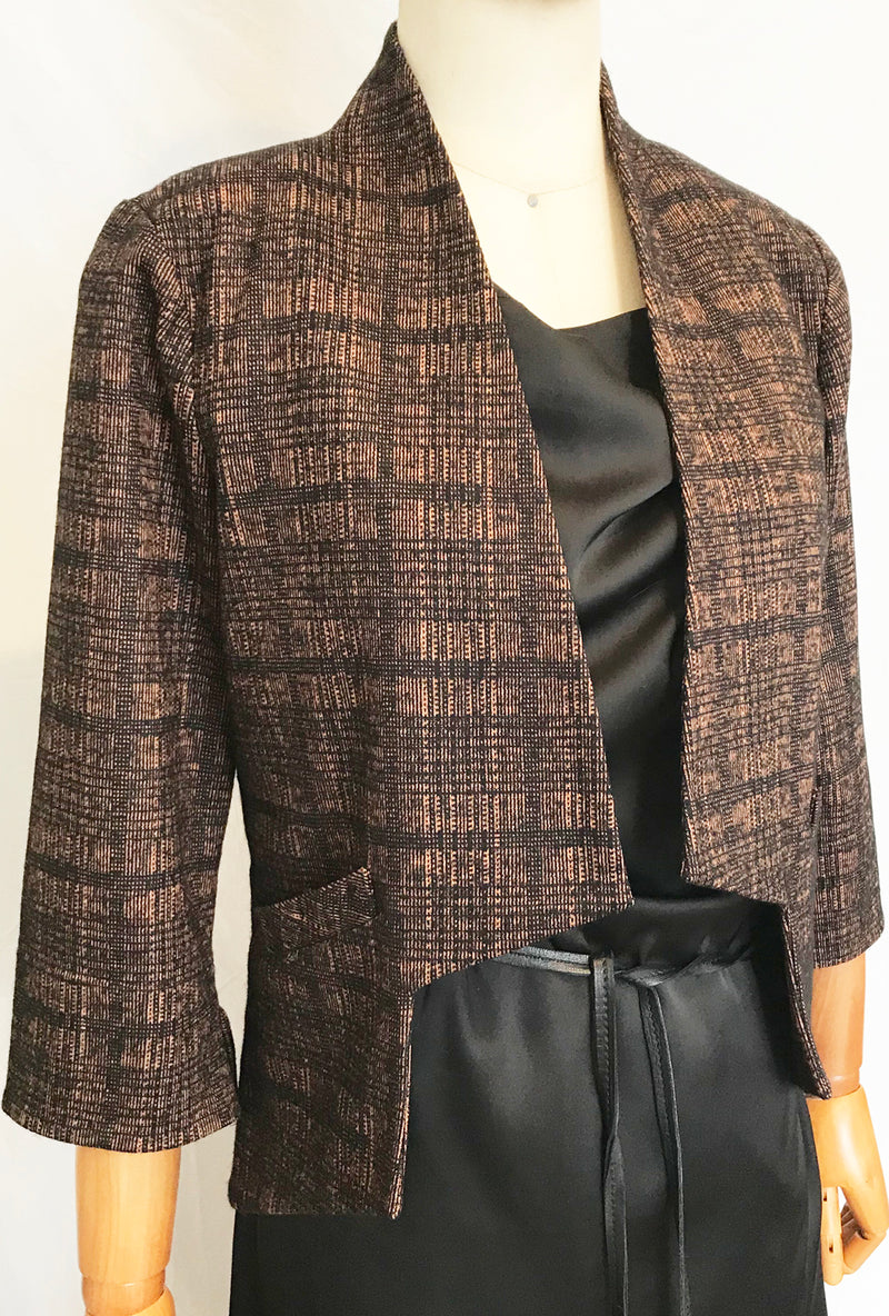Women's short jacket in rust and black plaid knit