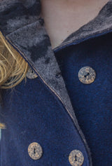 buttons on navy blue merino coat