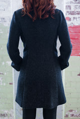 back of two tone gray ladies coat