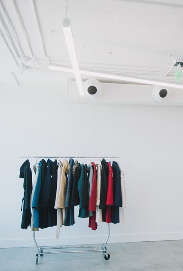 denovo coats hanging on clothing rack