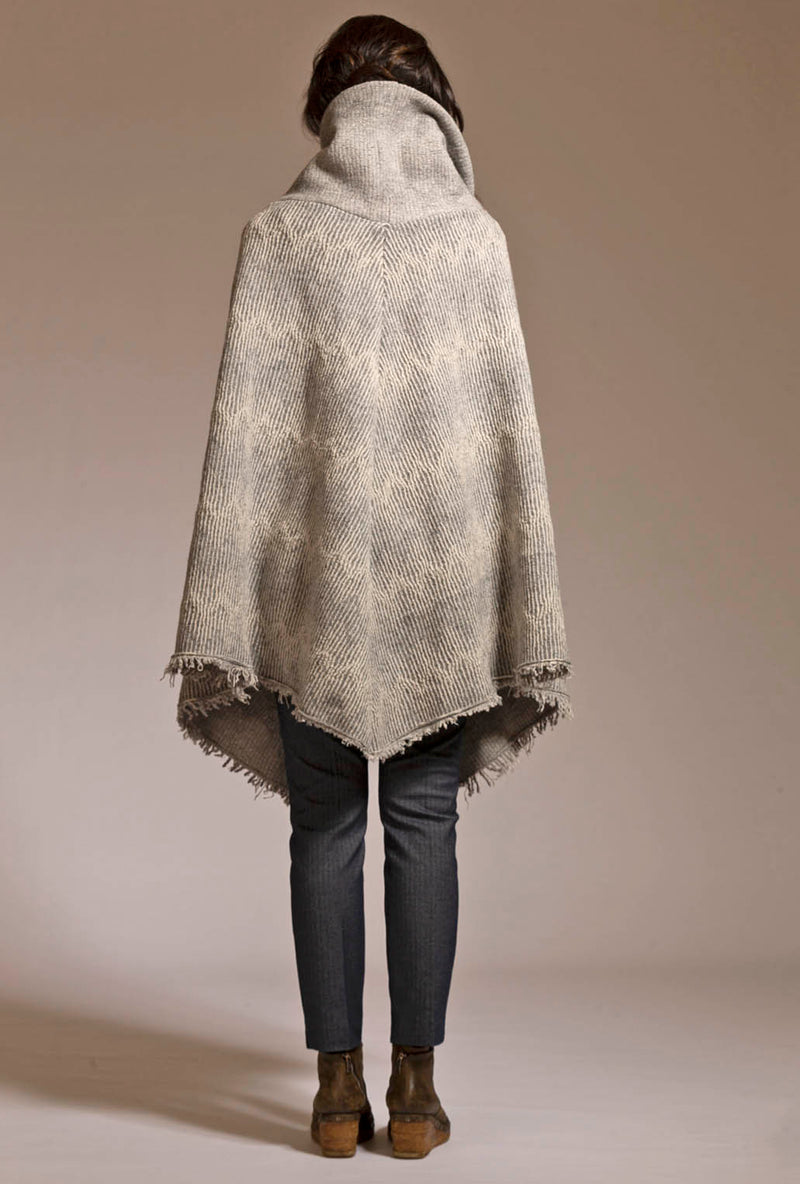back of gray merino knit poncho