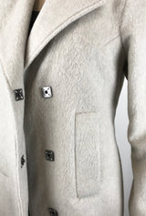 square snaps on winter white coat