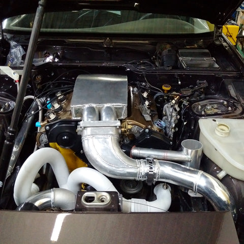 Mazda powered Porsche with fabricated intake and exhaust manifolds, as well as coolant swirl pot.
