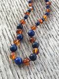 Polished Baltic amber and gemstone teething necklace