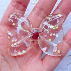 Transparent Bow Cabochon with Star Confetti | Large Bow Cabochon with Glitter Sprinkles | Kawaii Decoden Crafts | Resin Flatback | Fairy Kei Phone Case Decoration | Chunky Jewellery Making (1 piece / Clear / 54mm x 41mm / Flat Back)